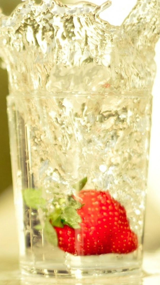 Strawberry Falling In Glass Of Water Iphone 11 Pro Max Wallpaper