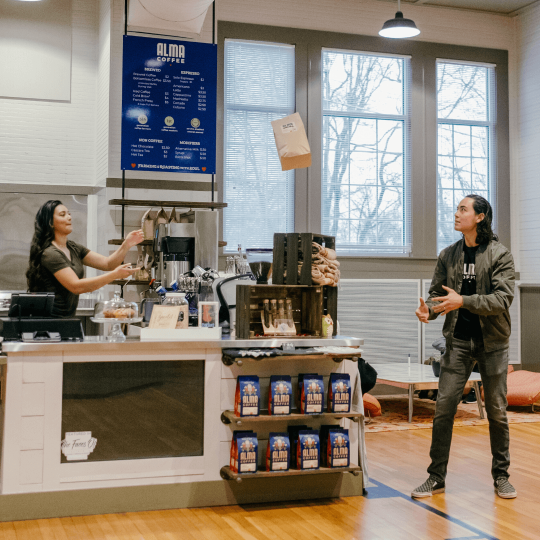 alma coffee owners, Harry and Leticia Hutchins making coffee in downtown woodstock