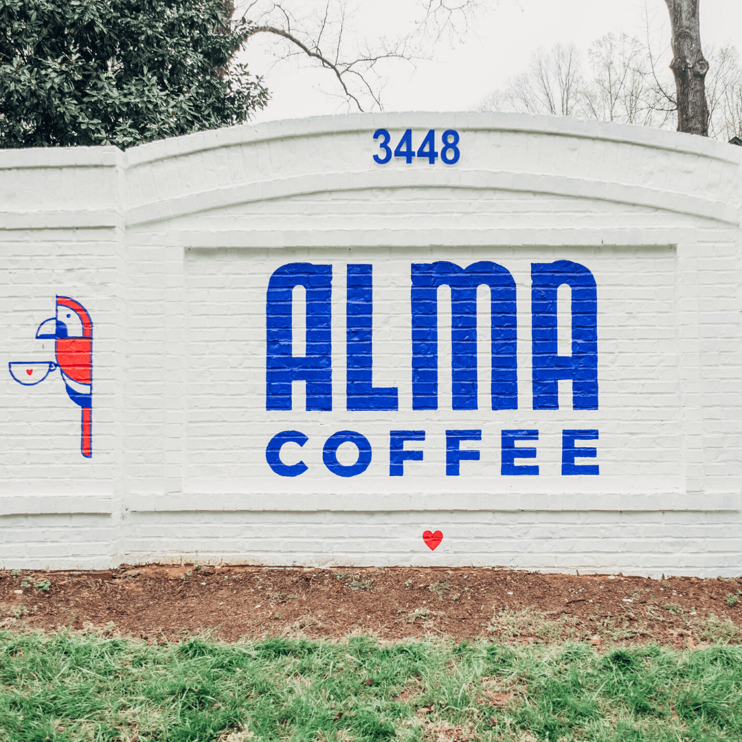 Alma Coffee street sign on highway 5 in Holly Springs, Georgia