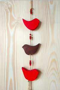 Colorful wooden bird hangings