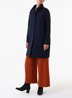 Egg-shaped coat in pressed wool