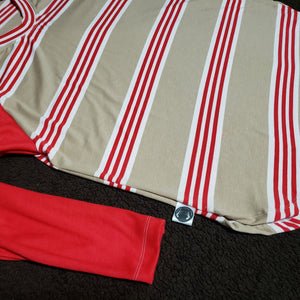 Over-sized red stripe raglan