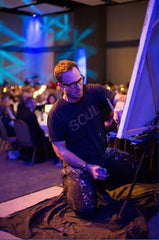 Artist John Bukaty Painting at a Live Event
