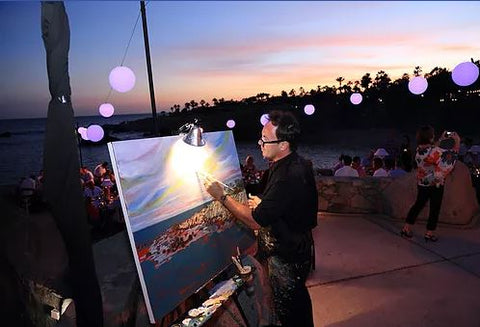 Artist John Bukaty painting live at an event