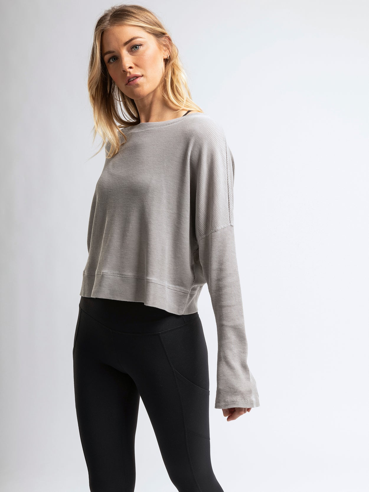 Textured, lightweight, long sleeve top with flared sleeves.
