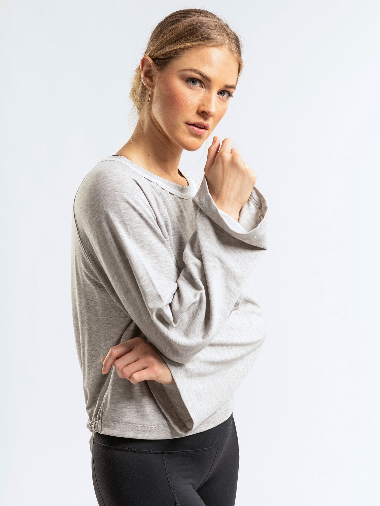 Gray open back sweatshirt with bell sleeves and easy tie option.