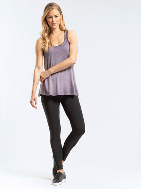 Lightweight tie back tank top with a scoop neckline.