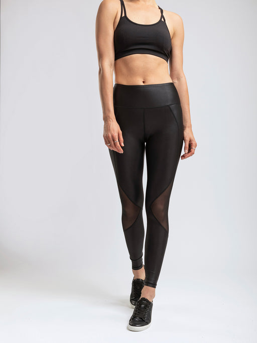 Shiny, black leggings with mesh inserts and a secure back pocket.