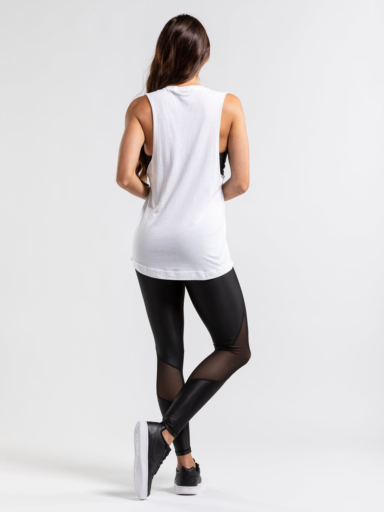 Lightweight white muscle tank with black shooting star print.