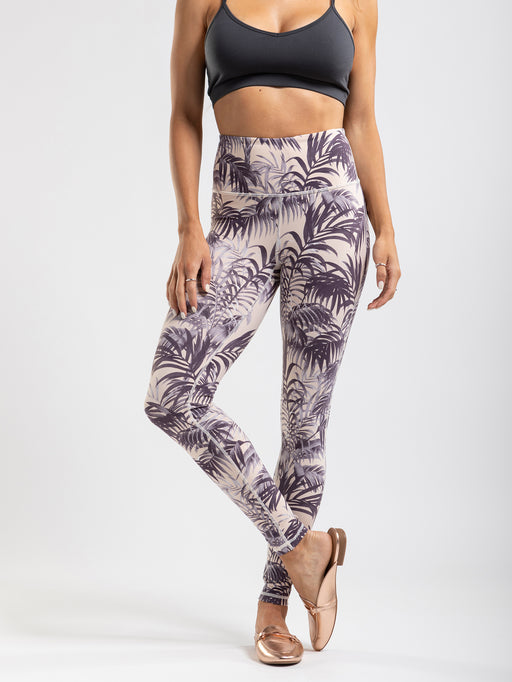 Purple palm print leggings on a blush tone with grey highlights. These have a high rise and secure front pocket.