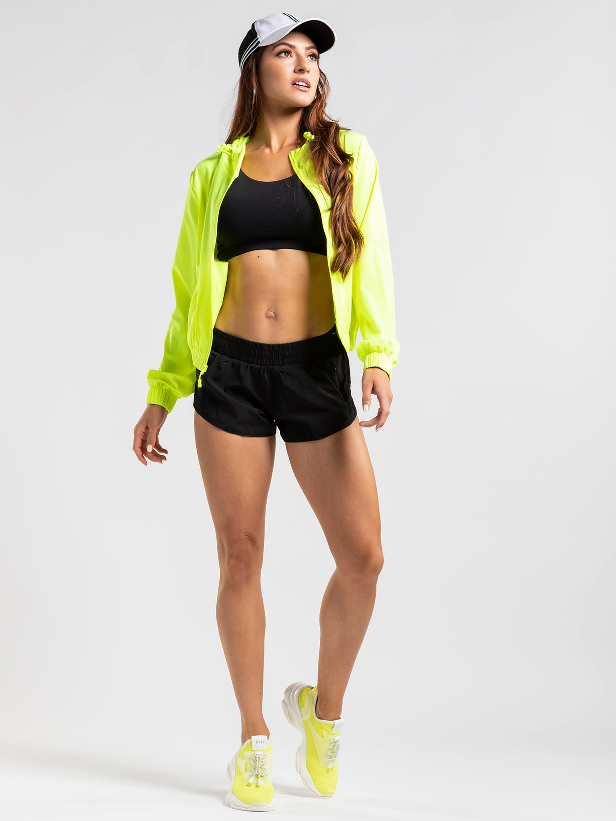 Short, black workout shorts with mesh inserts, a secure front pocket and elastic waistband.