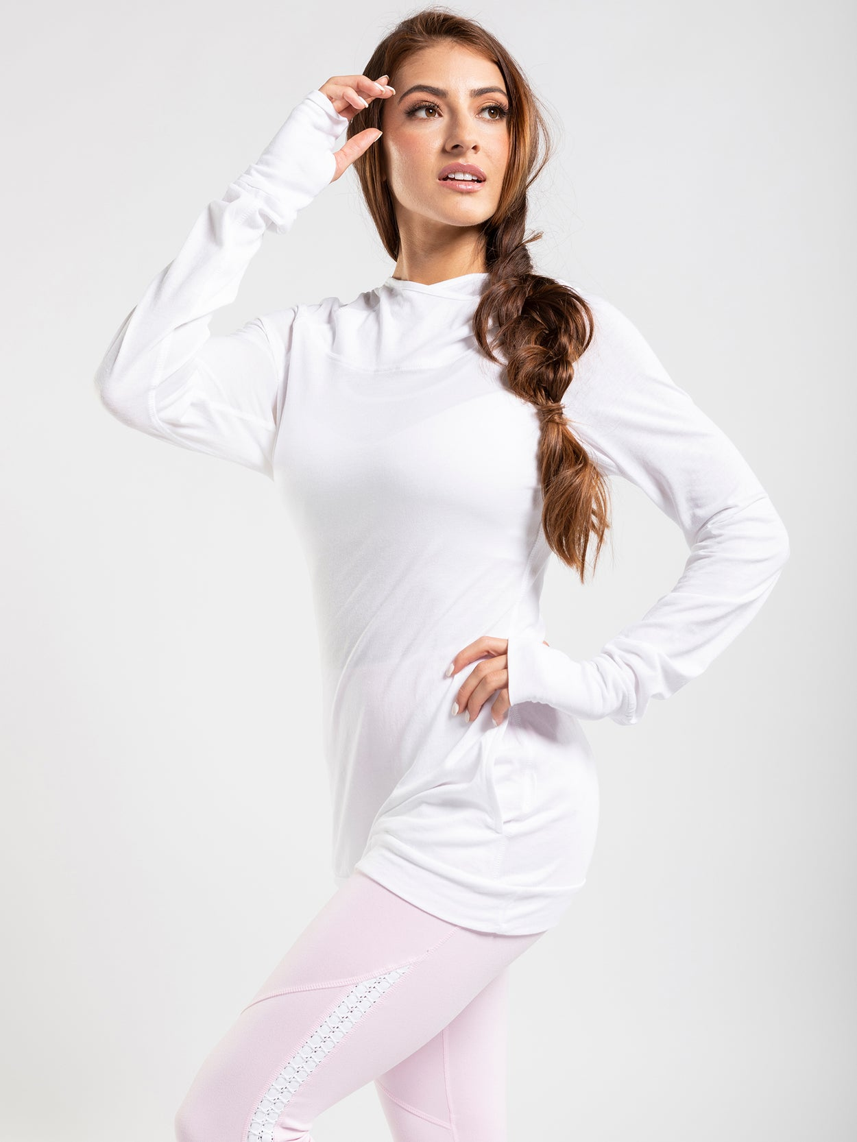 Excellent lightweight long sleeve layering top with thumb holes and a hood.