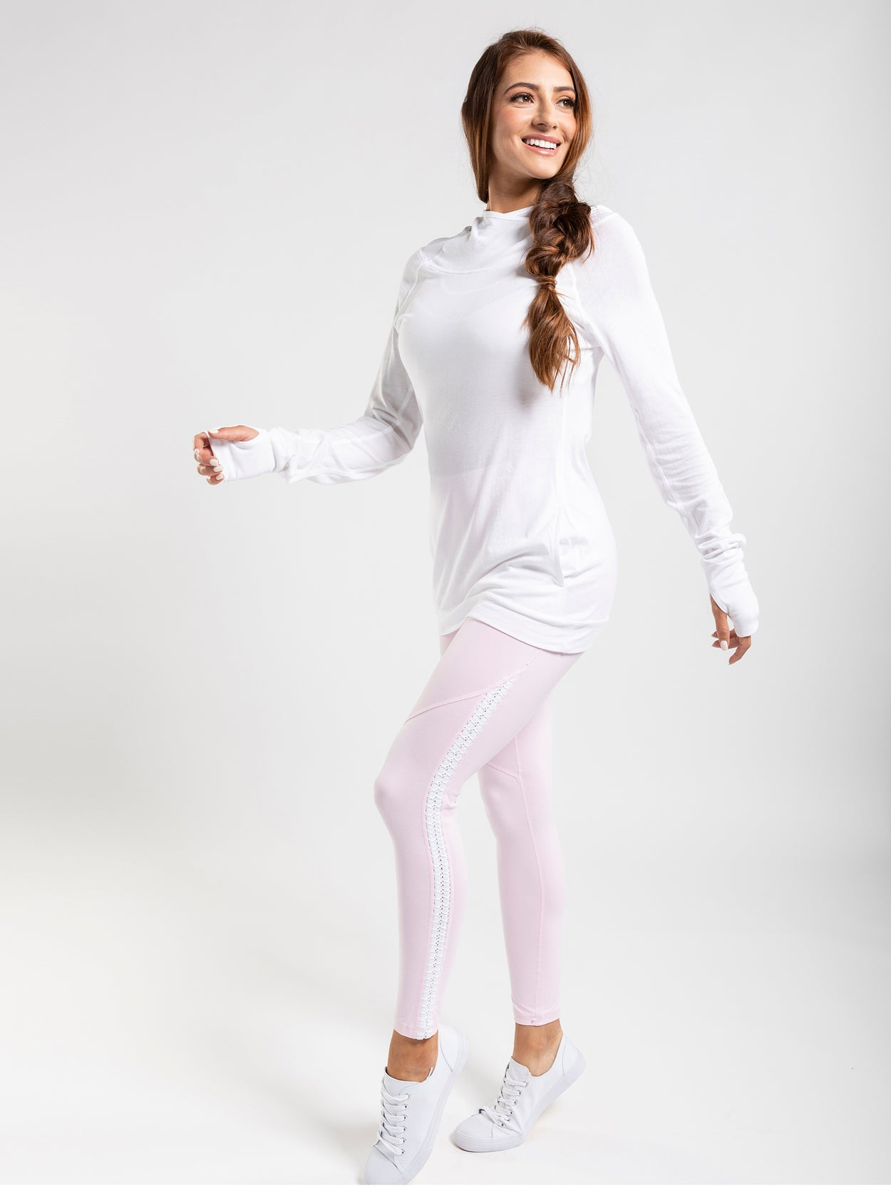 Soft, pink leggings with white lace-up side detail.