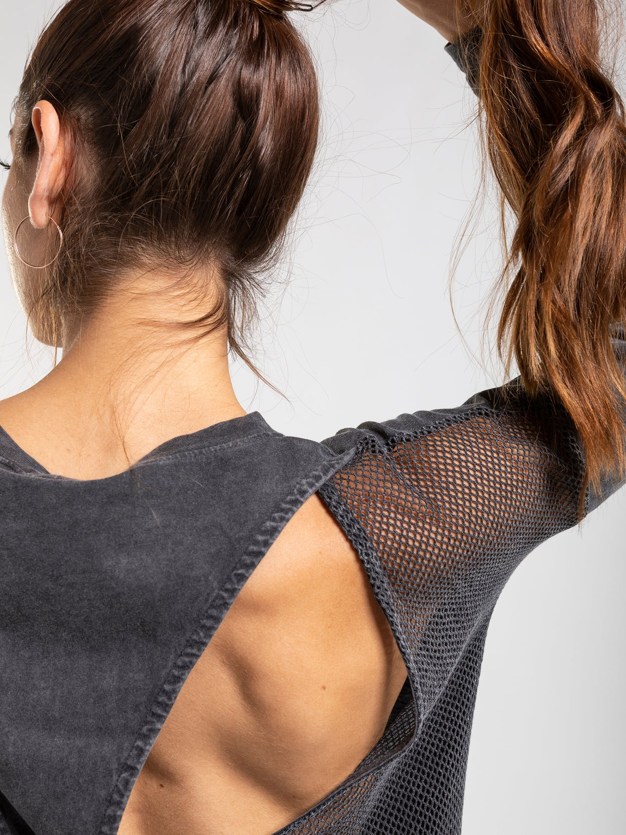 Long sleeve top with netted mesh back detail.