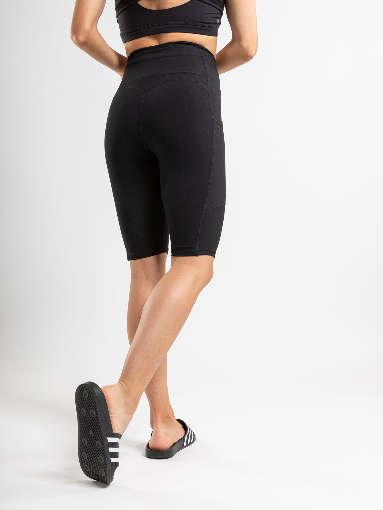 Black biker short with side pockets and a high rise.