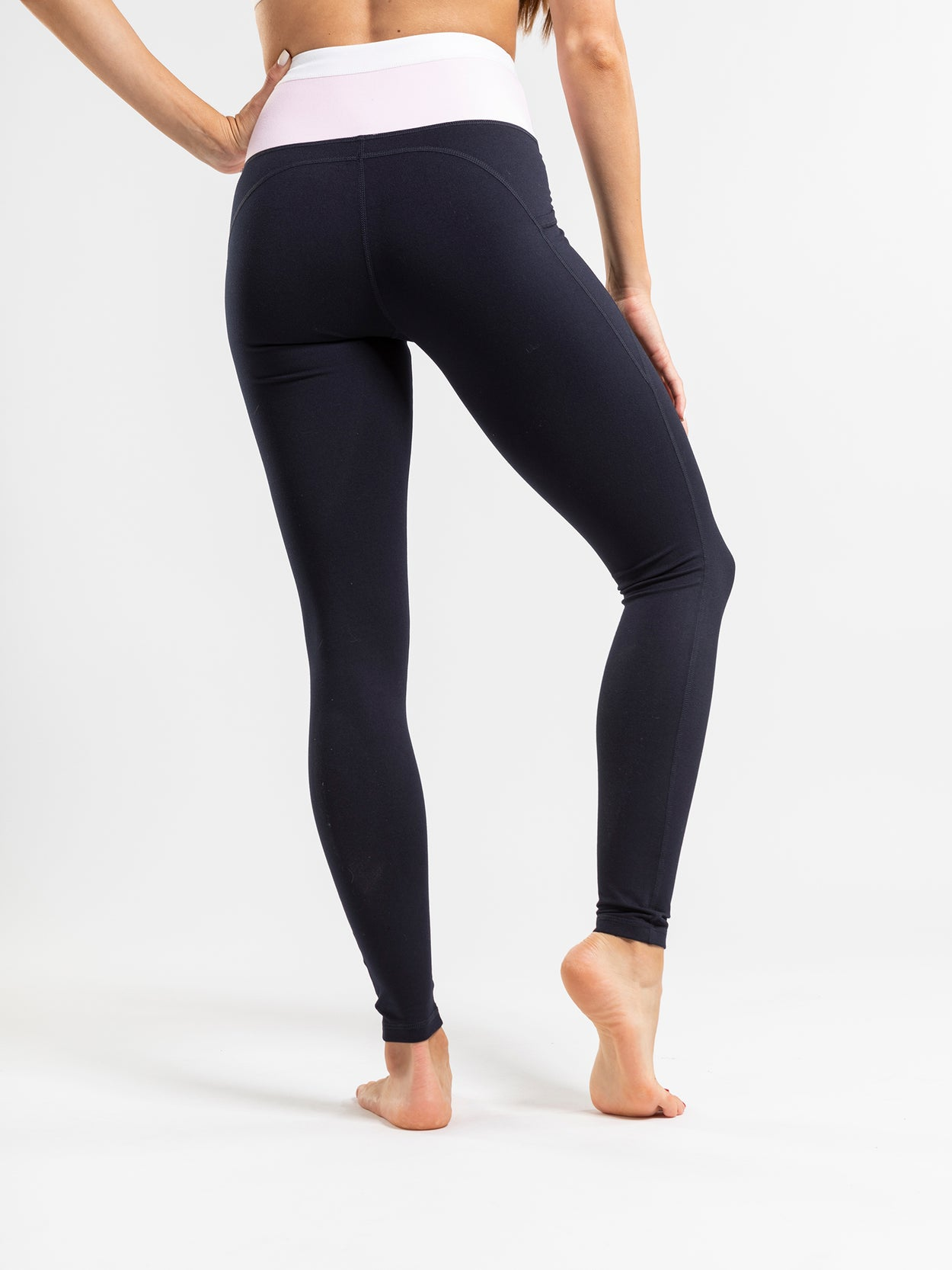 High rise navy leggings with contrast pink & white waistband.