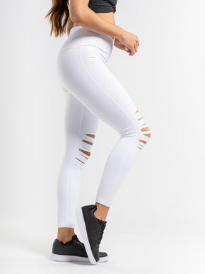 White ripped leggings with a high rise and interior pocket.