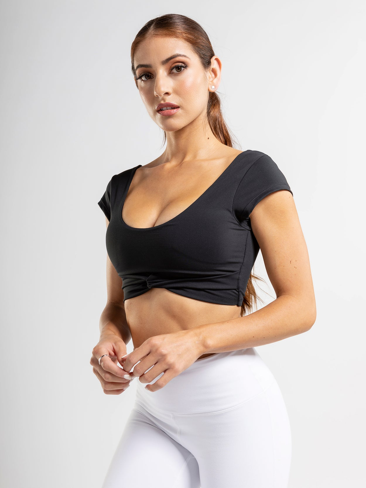 Short sleeve scoop neck crop top with twist front detail.