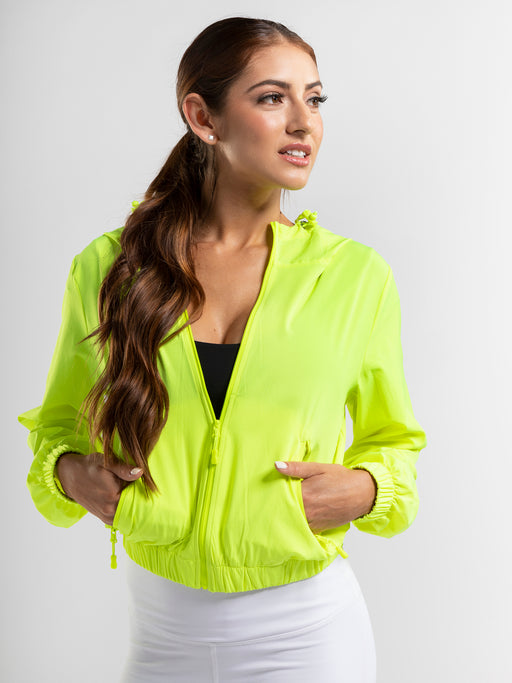 Neon yellow zip front windbreaker with secure pockets and a hood.