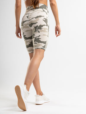 Camouflage print biker shorts with a high rise and interior pocket.