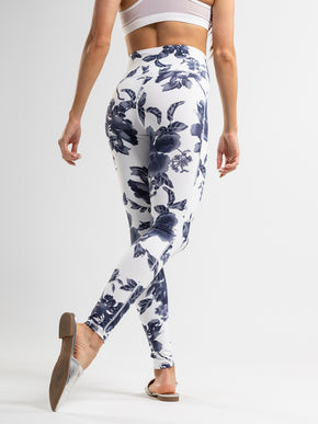 White leggings with a navy floral print, high rise and an interior pocket.