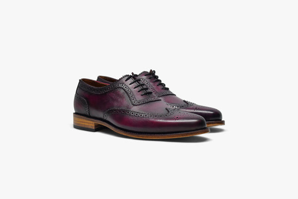 Oxford brogue shoe in oxblood color. Hand made leather shoe.