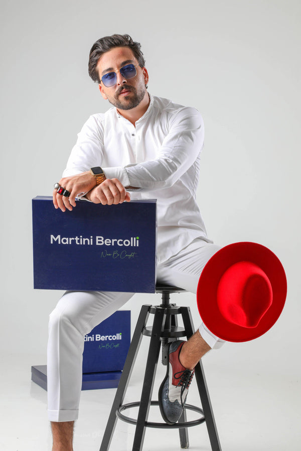 Brighter days call for lighter looks. So make sure you're wearing a Martini Bercolli B.L.E shirt when the sun decides to show its glorious face. You'll be feeling perfectly fine on even the stickiest of days. Crafted from cotton this all-white shirt, with its silvery embroidery to the mao collar for an extra sophisticated touch and silver-tone cufflinks fastening for an instant upgrade. Time to take your style to the next level. uk