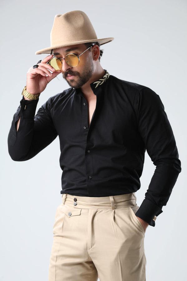 Stepping up your evening ensembles? Martini Bercolli will ensure that your look is the one that stands out. Crafted from cotton this all-black shirt, with its golden embroidery to the mao collar for an extra sophisticated touch and gold-tone cufflinks fastening for an instant upgrade. Level up. Get ready to steal the spotlight! france