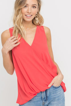 Poppy red draped chiffon crossover tank with slight high-low hem.  Priced at $28.00.