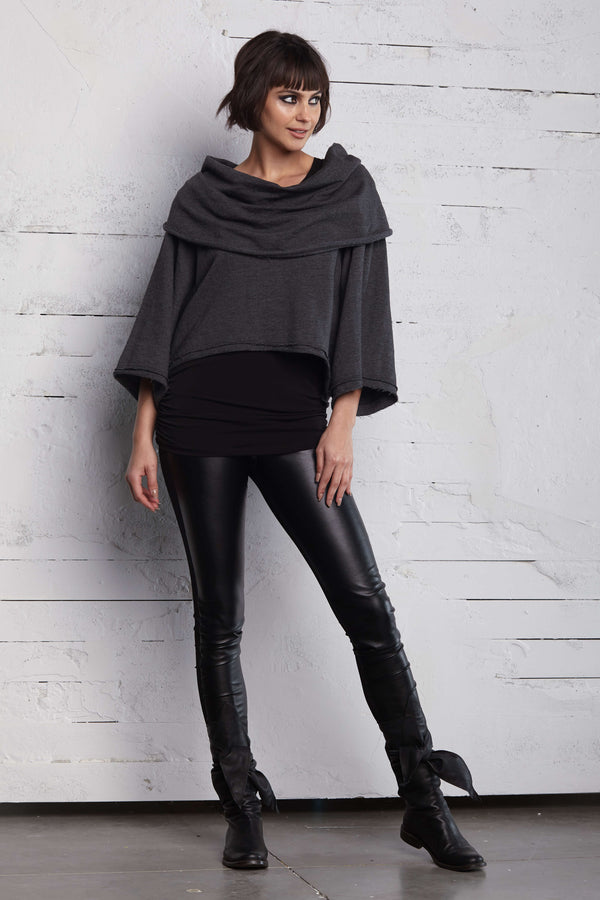 Fun dark gray cropped french terry sweater that can be worn off the shoulder or as a draped cowl neckline.  Layer with rouched tank top and leggings. Priced at $212.00.