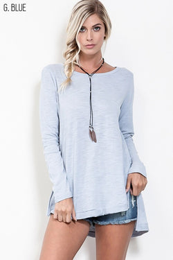 Raw edge cotton long sleeve top with high-low hem.  Available in blush and light blue.  Priced at $36.50.