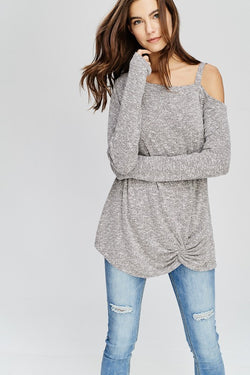 Ultra soft long sleeve asymmetrical twisted hem brushed two-tone knit sweater.  Will fast become one of your favorite tops. Priced at $40.00.