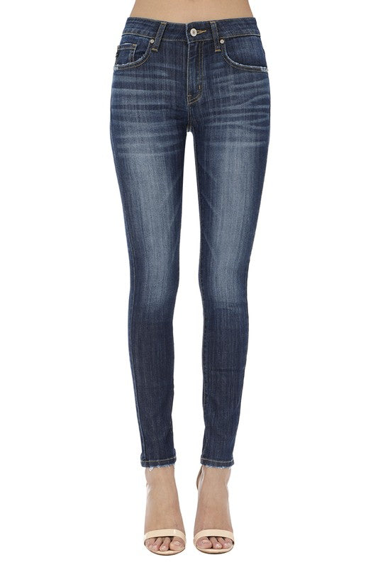 These Denim Skinnys are a must have! They are brought to us by Kancan and they come in a dark color. These jeans feature the five pocket style, a button and zipper for closure, whiskers, light fading and no destroy. On the back they are plain and at the bottom they are skinny. These jeans would look great with heels or sneakers!  Priced $49.95.