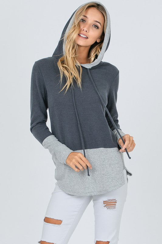 Charcoal and light gray color block comfy long sleeve hoodie.  Priced at $35.00.