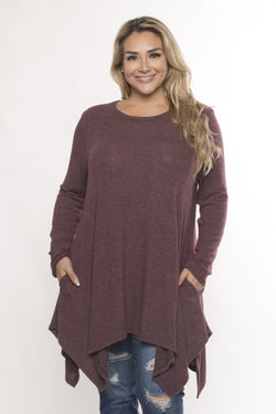 So soft you won't want to take it off.  Stylish brushed knit handkerchief hem long sleeve top with pockets.  Pair with leggings or jeans.  Priced at $45.00.