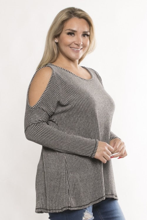 Cold shoulder cutouts expose some skin in an exceptionally soft long sleeve top that effortlessly wears with jeans or leggings. Priced at $40.00 and $42.00.
