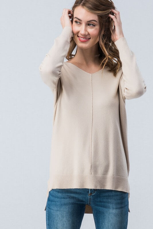 This sweater will quickly become one of your favorites! Soft high-low tunic sweater that can easily be dressed up or down. Thin enough to layer. 55% Cotton/ 45% Rayon. Super soft high-low sweater. Priced at $40.00.