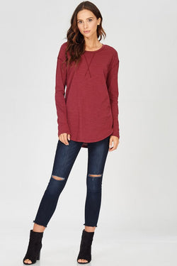 Another throw on and go long sleeve top that pairs with jeans or  layer under a sweater.  Slub jersey knit, x-stitched, crewneck, shirttail hem t -shirt.  100% Cotton. Available in wine and navy.  Priced at $32.00.