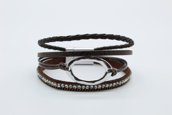 Bracelet - Brown Thin Magnetic with Silver Hoop. Four brown vegan leather straps with a silver hoop.  Priced at $13.00.