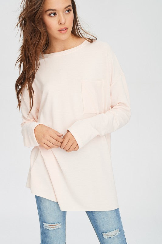 Great casual jean or legging top.  Long sleeve light peach crewneck t-shirt/mini dress with chest pocket.   97% Polyester. 3% Spandex. Priced at $42.00.