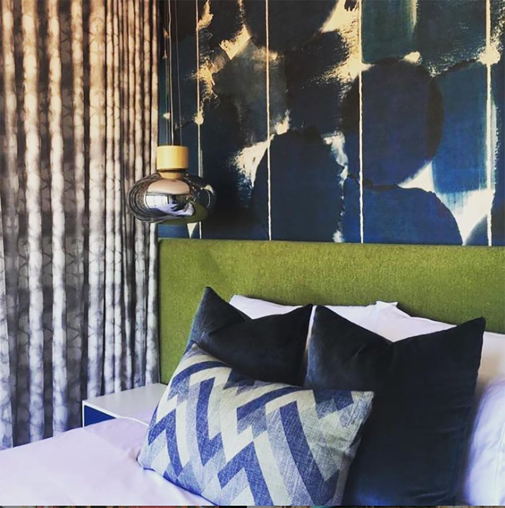 Blue pattern wallpaper in a bedroom created by interior design company