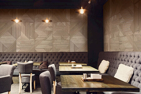 A contemporary restaurant featuring textured wood wall panelling in a natural wood