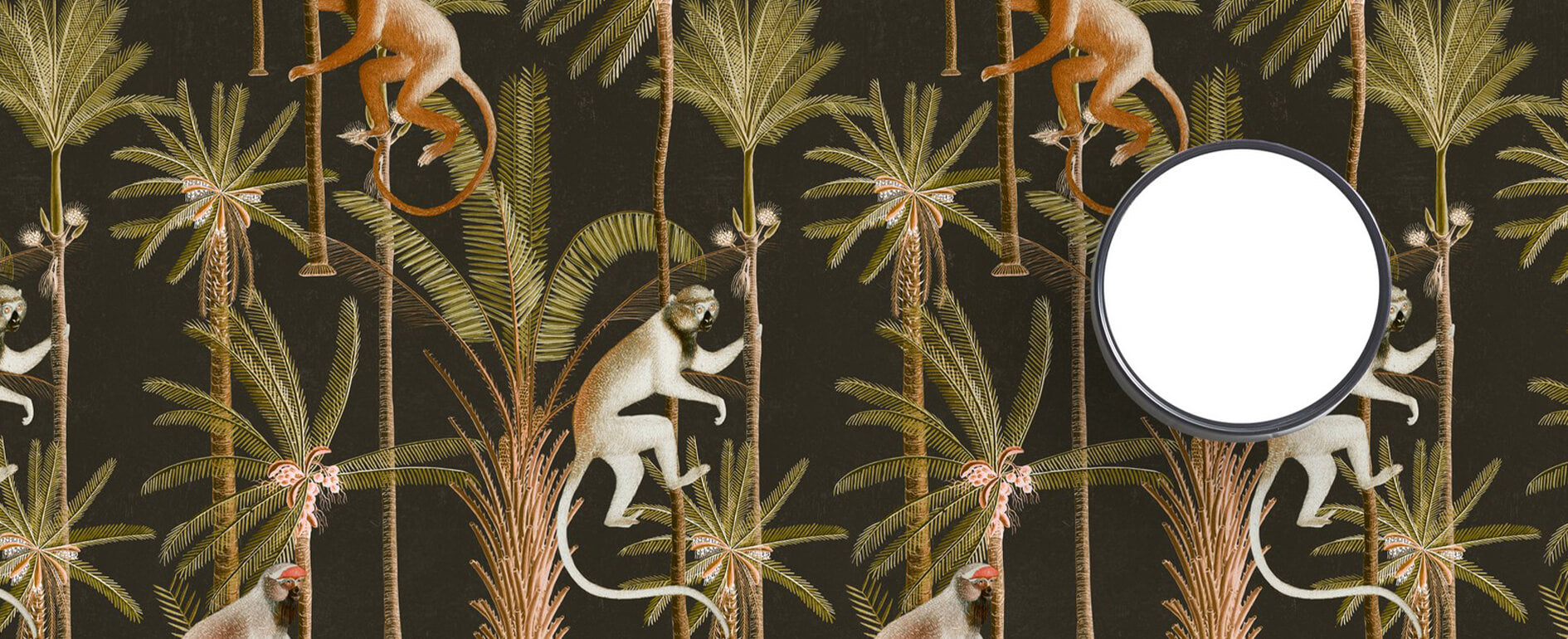 Close-up of designer Mind The Gap wallpaper which features monkeys and palm trees on a black background