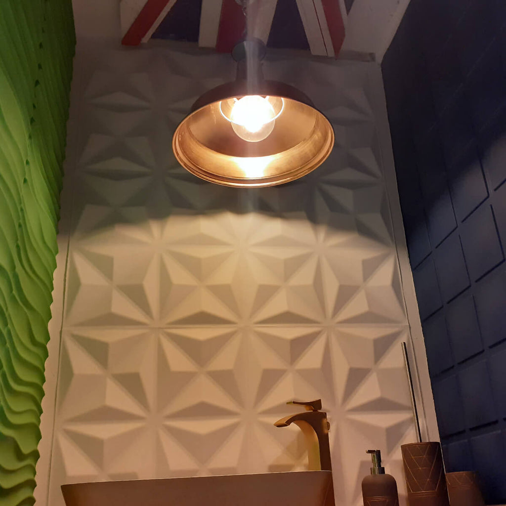 Decorative 3D wall panels painted green and blue within our showroom in Bolton