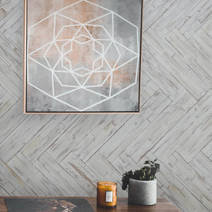DIY wood wall panelling applied to a home interior with wall decor added