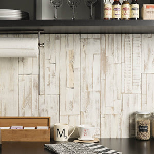 Light wood peel and stick panelling applied to a kitchen