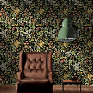 A vibrant floral tapestry style wallpaper featuring flowers and woodland creatures used within a sitting room