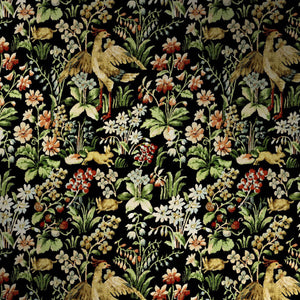Close up of vibrant floral tapestry wallpaper. The design features an array of flowers, birds and woodland creatures.