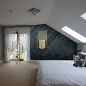 Blue finished wooden peel and stick panels used as a feature wall within a bedroom