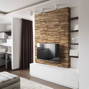 Reclaimed wood wall panelling used as a feature wall behind a tv unit